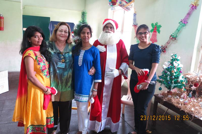 Ex-students pose with Chairperson and Santa
