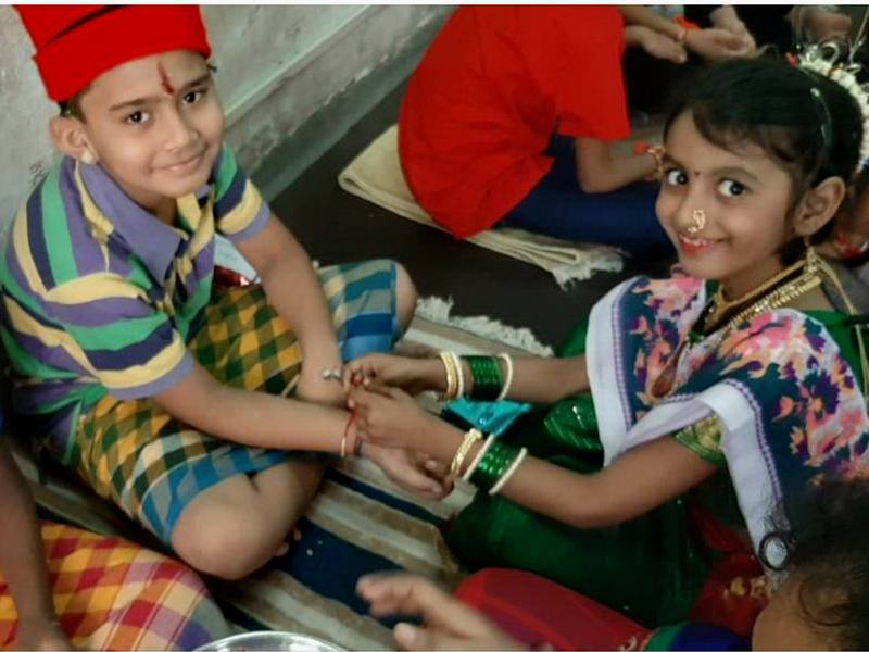 Tying Rakhi on Rakshabandhan Day
