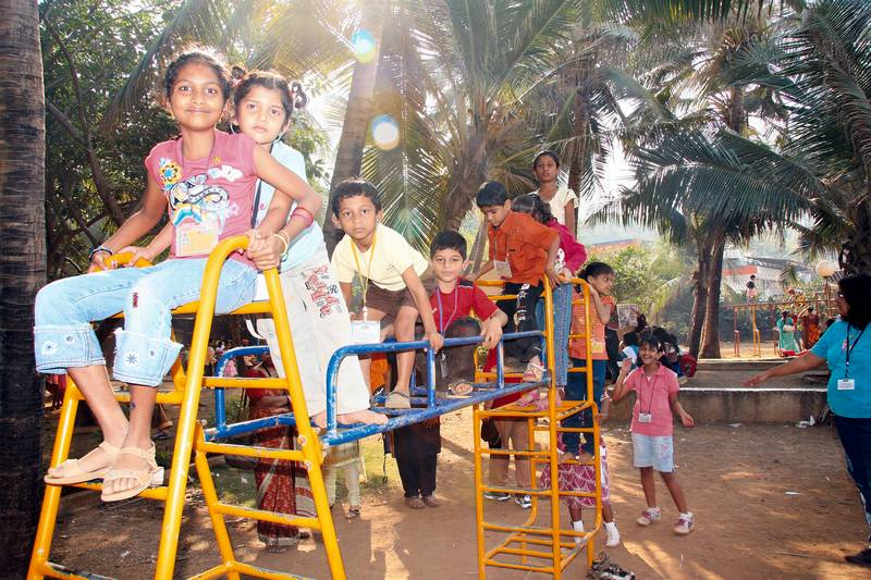 Clambering up the jungle-gym at Tata Garden