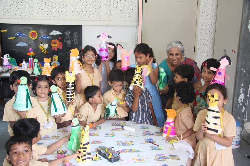 Children having a ball making hand puppets dolls