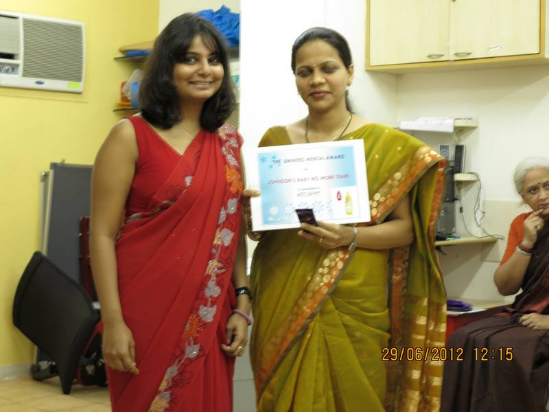 Parent Counsellor Aditi gets a certificate from UMMEED centre