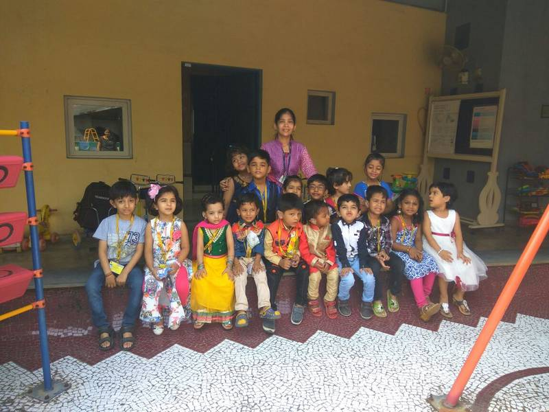 Line up of English medium kids with their teacher Sarita
