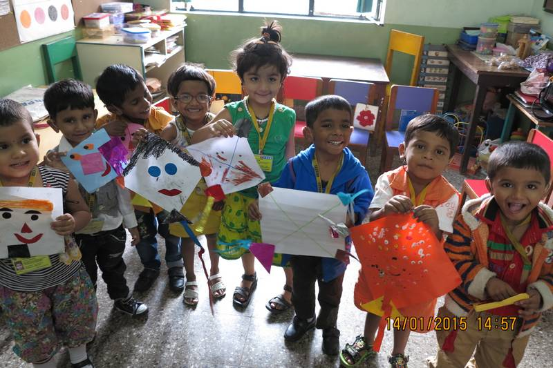 Our little toddlers looking extremely pleased with themselves on making their own kites