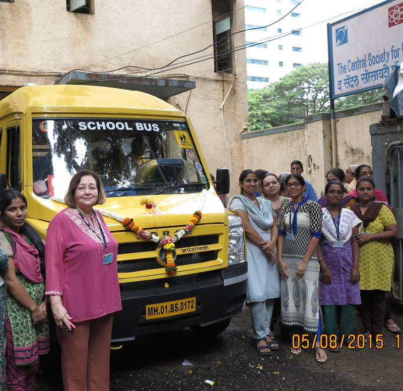 Our new 'FORCE Motors School Bus' alongside our teaching staff
