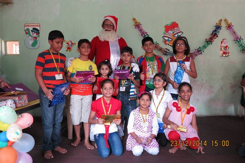 Santa Claus distributes presents at the Xmas Party
